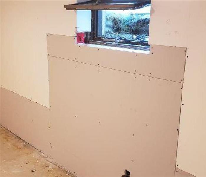 A wall with new drywall that still needs to be taped and finished