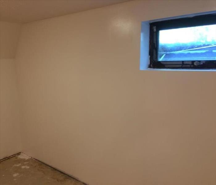 A completely rebuilt wall with a fresh coat of paint